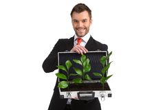 De koffer van de mensenholding met installaties het groeien Stock Afbeeldingen