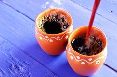 De koffie giet Stock Afbeeldingen