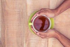 De koffie van de zakenmanholding Stock Foto