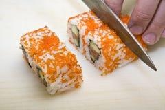 De kok op keuken bereidt Japanse susi voor royalty-vrije stock foto