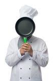 De kok sluit het gezicht met een pan Royalty-vrije Stock Foto