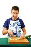 De kok snijdt prei Stock Foto