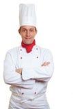 De kok van de chef-kok met gekruiste wapens Stock Foto's