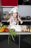 De kok van het meisje stock foto
