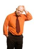 De komische vette man in een oranje overhemd Royalty-vrije Stock Foto's