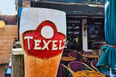 Large wooden replica of a beer mug as advertisement for local beer brand called `Texlers` on island Texel
