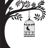 De kooi en de boom van de vogel royalty-vrije illustratie