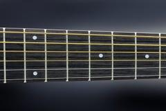 De koorden en de lijstwerken van de gitaar stock afbeeldingen