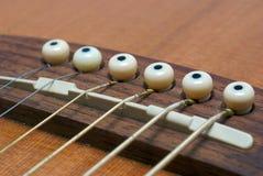 De koorden van de gitaar stock afbeelding