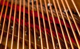De koorden van de piano in macro Royalty-vrije Stock Afbeeldingen
