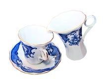 De kop en de waren van de koffie voor room Stock Afbeeldingen