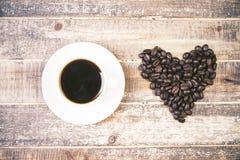 De kop en het hart van de koffie Stock Afbeelding