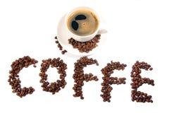 De kop van de koffie met bonen Stock Afbeelding