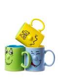 De kop van de koffie met een grijns stock foto