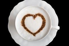 De kop van de koffie met hartvorm stock afbeelding