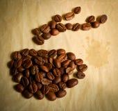 De kop van de koffie met stoom Stock Foto