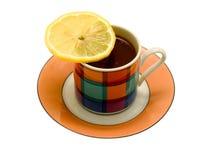 De kop van het porselein van koffie en een plak van een citroen Royalty-vrije Stock Afbeeldingen