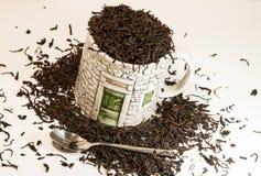 De kop van de thee met lepel Stock Fotografie