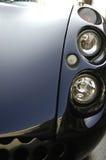 De koplampclose-up van de sportwagen Stock Afbeelding