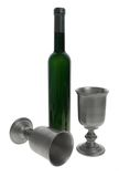 De koppen en de fles van de wijn Stock Foto