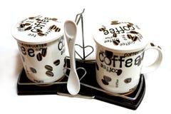 De koppen en de koffie-lepel van Cofee Royalty-vrije Stock Foto's