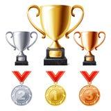 De koppen en de medailles van de trofee Stock Fotografie
