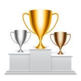 De koppen van de trofee op podium Royalty-vrije Stock Afbeeldingen