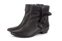 De korte zwarte laarzen van dames stock afbeelding