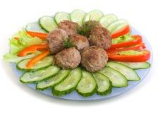 De koteletten en de komkommer van het vlees Royalty-vrije Stock Fotografie