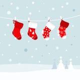 De kousen van Kerstmis in de winteraard. Royalty-vrije Stock Foto's