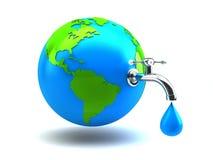 De kraan van het water op groene aarde Royalty-vrije Stock Fotografie
