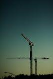 De kraansilhouet van de bouw (zonsondergang) Stock Fotografie