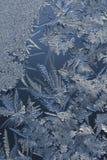 De Kristallen van het ijs op Glass.123 Stock Afbeeldingen