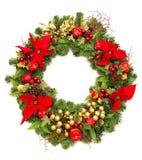 De kroon van Kerstmis met poinsettiabloemen stock foto's