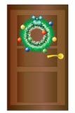 De kroon van Kerstmis op de deur. Stock Afbeelding