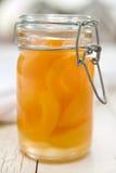 De Kruik van de Metselaar van perziken Stock Foto's