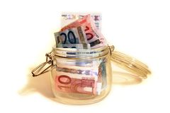 De Kruik van het geld Stock Afbeeldingen