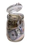 De kruik van het glas met dollars royalty-vrije stock afbeeldingen