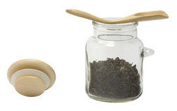 De kruik van het glas met een houten lepel Stock Foto