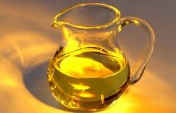 De kruik van het glas met olijfolie Stock Fotografie