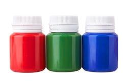 De kruiken van de kleurengouache en kleuren acrylverven royalty-vrije stock afbeelding