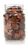 De kruikhoogtepunt van het glas van muntstukken royalty-vrije stock afbeelding