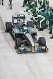 De kuilen van Kovalainen bij Maleise F1 Stock Afbeeldingen
