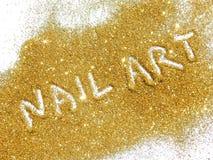 De Kunst van de inschrijvingsspijker op goud schittert fonkeling op witte achtergrond Royalty-vrije Stock Foto's
