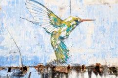 """De kunst van de """"kolibrie"""" muur door beroemde kunstenaar, Ernest Zacharevic in Ipoh wordt geschilderd die Royalty-vrije Stock Afbeeldingen"""