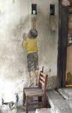 De kunst van de Penangstraat - jongen op stoel Royalty-vrije Stock Foto's
