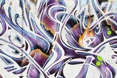 De kunst van de straat, segment van een stedelijke graffiti op muur Stock Foto