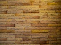 De kunstbakstenen muur met warm licht Stock Afbeeldingen