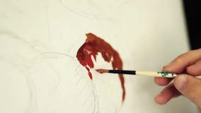 De kunstenaar bereidt de verf voor stock videobeelden
