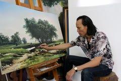De kunstenaar trekt landschap Stock Afbeeldingen